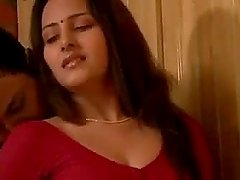 Stunning Indian babe in red clothes in..
