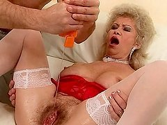 Lewd granny Effie gets her hairy pussy..