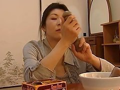 Mature Japanese housewife plays with a..