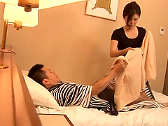 Hot Japanese Milf Gives Handjob In Bed.