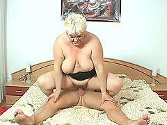 Fat blonde granny Iman rides a cock in..