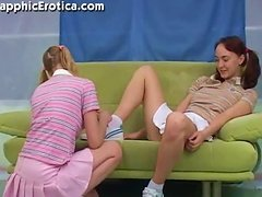 Desirable schoolgirls are having fun on the couch