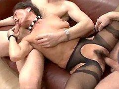 Russian Mature woman sucks two dicks..