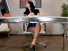 brunette rubs her feet on a big-ass..
