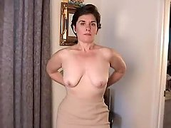 Mature brunette shows off her flabby..