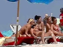 Nude beach hotties get filmed with a..