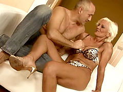 Mature whore gets some help using her..