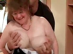 Busty granny lets the man play with..