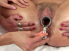 Randy old slut enjoying a speculum and..