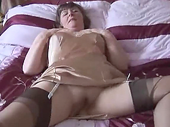 Slutty granny plays with a dildo and..