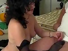 Mature lady licks off the cum from her..