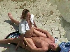 Horny couple banging on a beach caught..