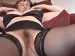 Mature in Stockings spreads her legs to display her twat