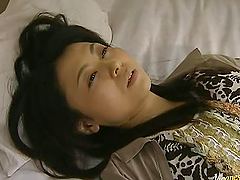 Horny Japanese woman masturbates and..