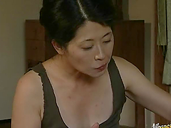 Hot Japanese couple having sex while..