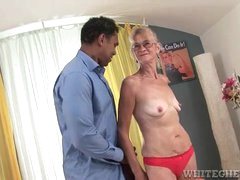 Granny sucks on a massive black cock