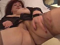 Mature brunette in stockings enjoys..