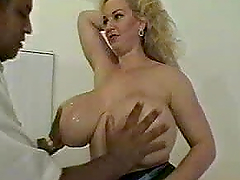 Big-breasted mature blonde satisfies a..