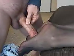 Pretty girl gives a footjob and gets..