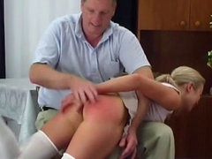 Slender blonde being spanked with..