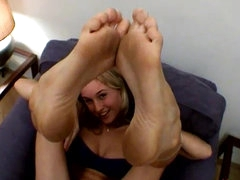 Playful sweetie licks her flawless feet