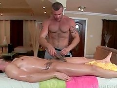 Tattooed gay masseur giving blowjob to..
