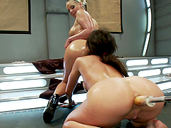 Oiled Up Lesbians Fucked in Both Holes..