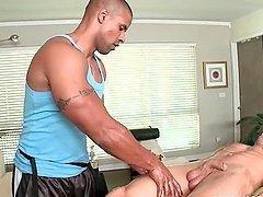 Gay masseur giving handjob to his..