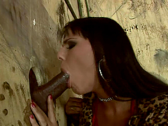 Horny brunette enjoys that huge black cock in the glory hole