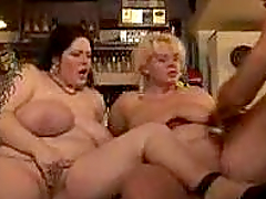 Two BBW girls are sharing a huge cock in the bar