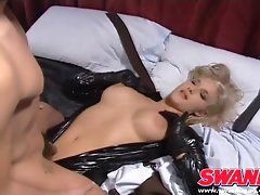 Cocksucking blonde in a black latex..