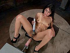 She uses a dildo and a sex machine
