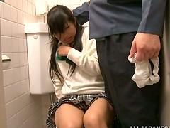 Shy Japanese girl in school uniform..