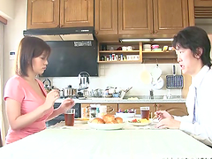 Busty Japanese mom lets her hubby play..