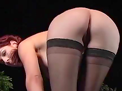 Redhead in stockings gets fucked..
