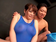 Busty Japanese in a swimsuit gets..