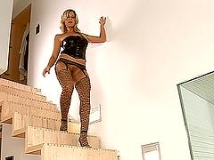 Blonde milf Carol G. strips and shows..