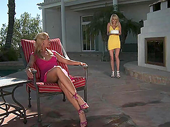 Two stunning blondes lick their feet..