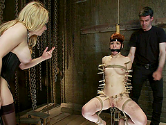 Bondage Scene With A Submissive Redhead