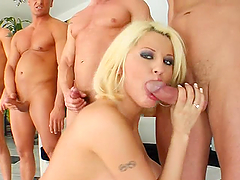 Guys line up to cum all over her face
