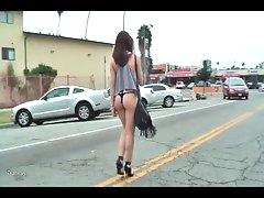 Girl walks to her car in thong bikini..