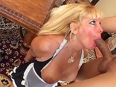 Nasty maid Lexxy Foxx fucks her master in the living room after sucking his dick