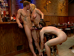 Dominatrix has fun with two male slaves