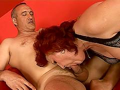 Redhead granny is enjoying the passion