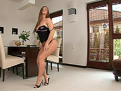 Rita Faltoyano strips and plays with her meaty pussy