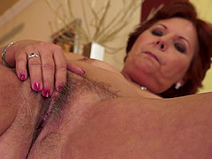Horny granny toys her hairy pussy and..