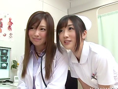 Two Japanese nurses finger and toy..