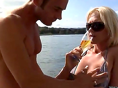 Blonde sucking and fucking her man on..