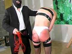 Redhead Mature's Tied Up And Spankes..