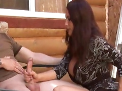 Brunette with big boobs is wanking a..